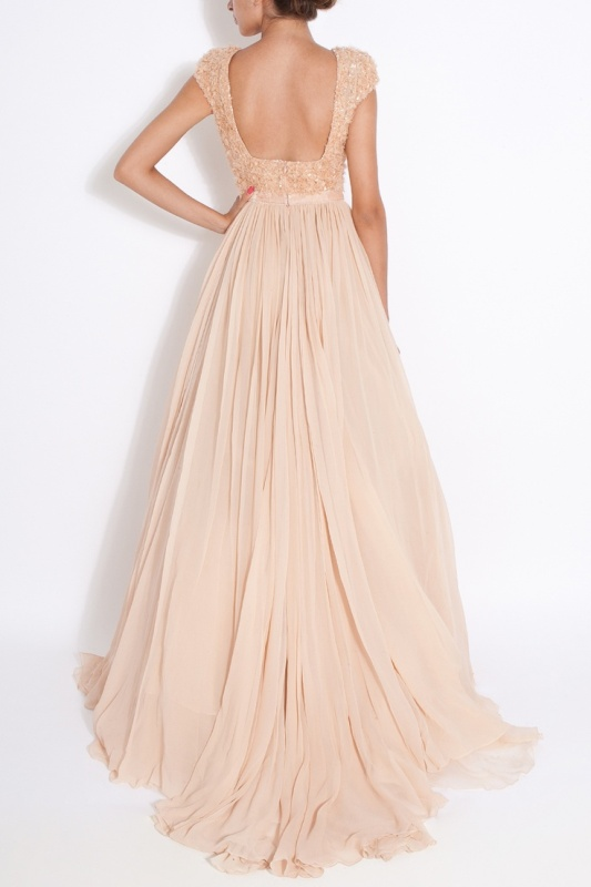 a blush A line wedding dress with a fully embellished bodice with short sleeves, an open back and pleated skirt