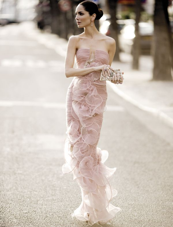 a unique very fitting blush wedding gown with sheer ruffles that form flowers looks very unusual and statement like