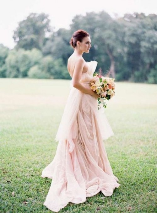 a blush A-line strapless wedding dress with lots of draperies and catchy sculptural detailing for a wow look