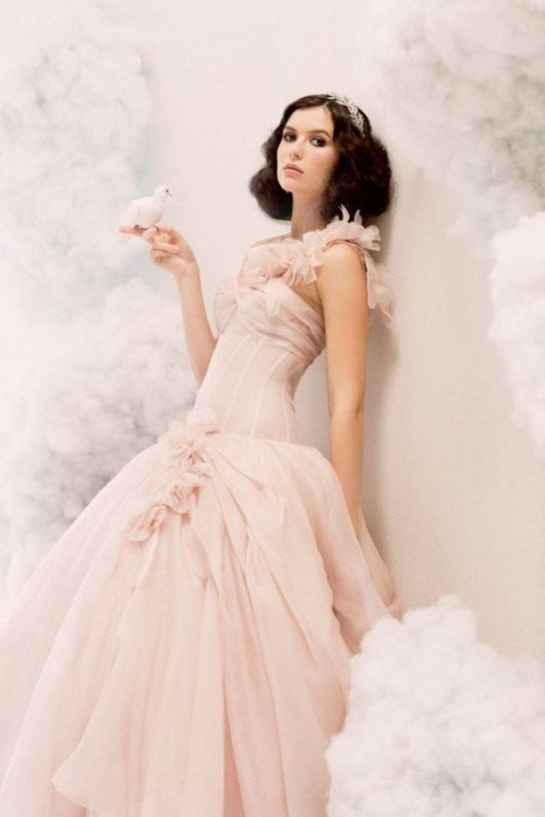 a blush wedding ballgown with a lace one shoulder strap, a layered skirt for a modern princess