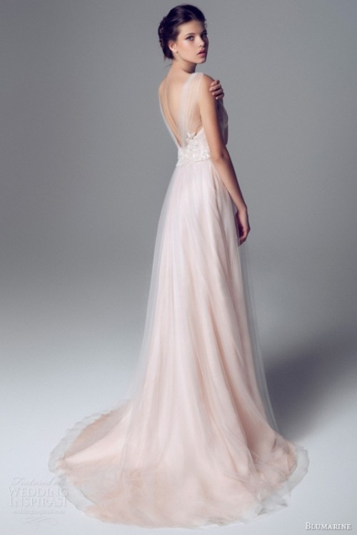 a delicate blush A-line wedding dress with an open back, illusion straps and a layered skirt for a tender outfit