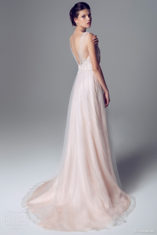 a delicate blush A line wedding dress with an open back, illusion straps and a layered skirt for a tender outfit