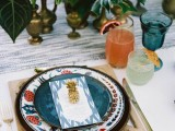 a tiny gilded pineapple will accent a wedding place setting making it feel very tropical and bold
