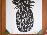 a graphic pineapple artwork will accent your dessert table or any other space in your tropical wedding venue