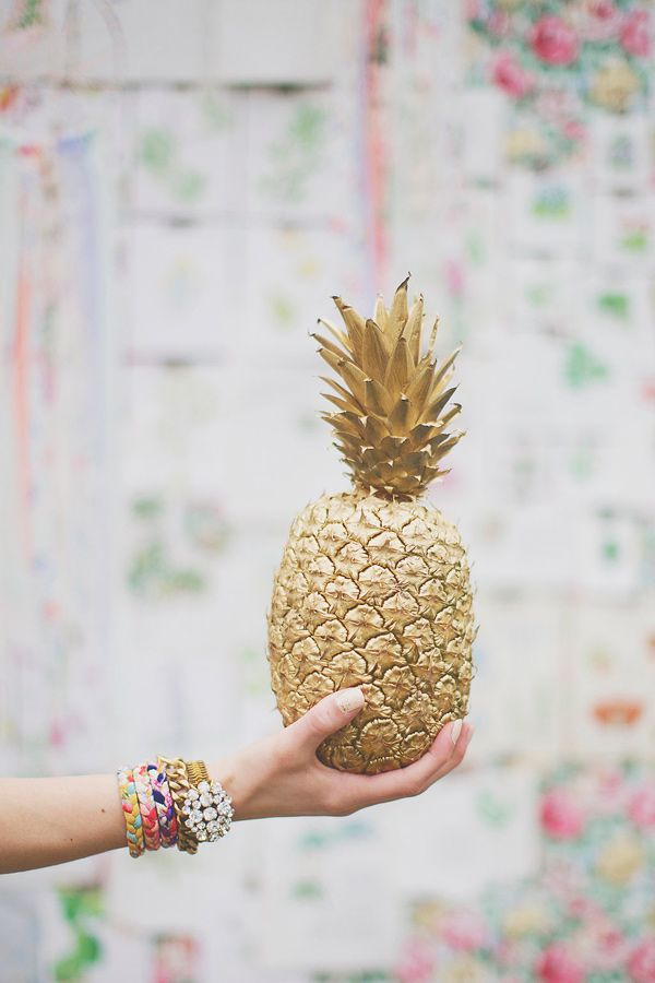 a gilded pineapple as a wedding decoration is a very cool and cute idea, you can eat it later