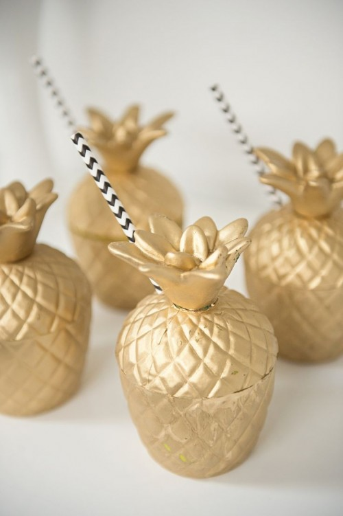 gilded pineapple jars for drinks will perfectly match any tropical-themed wedding event