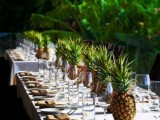 a pineapple table runner is ideal for a tropical wedding tablescape, it's very easy to recreate