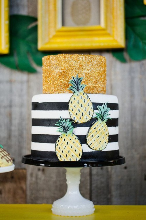 a fun wedding cake with a tropical and gold glitter tier and fun pineapples attached is a bold and cool idea for a modern tropical wedding