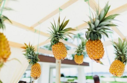 hang some pineapples over the reception space to make it feel really tropical and bold