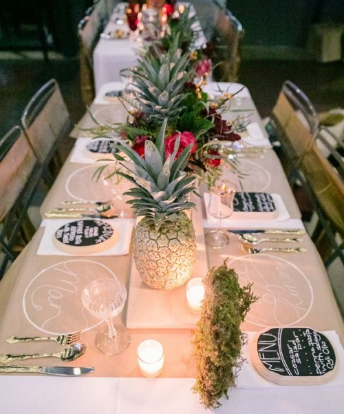 whitewashed pineapples and super bold blooms and candles will make up a chic and bright modern tropical table setting