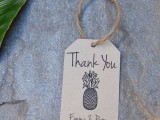 a gift tag with a pineapple can be a nice way to personalize a wedding favor
