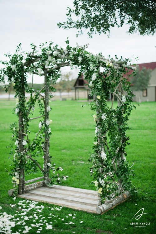 a very fresh spring wedding arch done only with greenery and white blooms is very inspiring