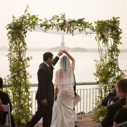 a greenery and white bloom wedding arch is sprign classics that always works