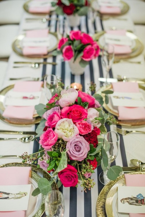 a bold and chic Valentine's Day wedding centerpiece with hot pink, lavender, white blooms and greenery sets the tone at the table
