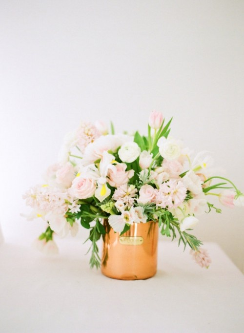 a tender blush and white floral weddng centerpiece like this one will fit a Valentine's Day wedding or any other