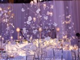 a glass Christmas tree with crystals, flowers, candles in candleholders is a very refined and elegant option