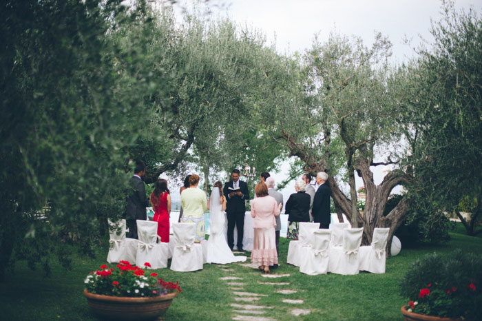 Picture Of intimate tuscan villa destination wedding under olive trees  16