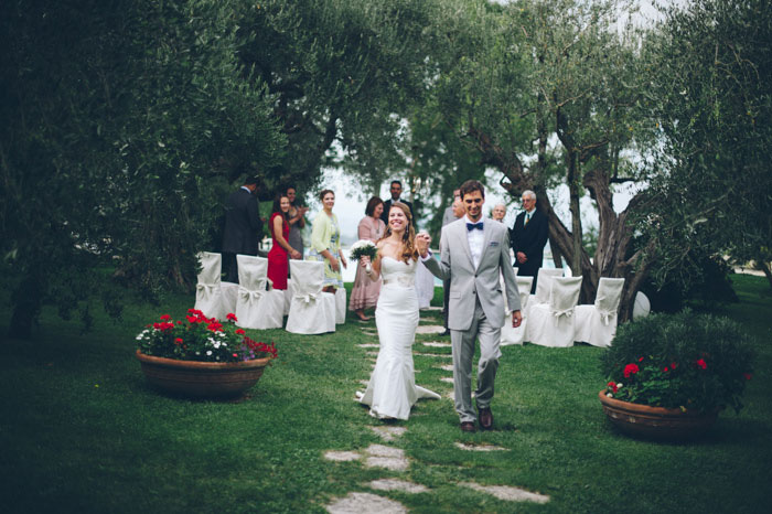 Picture Of intimate tuscan villa destination wedding under olive trees  19