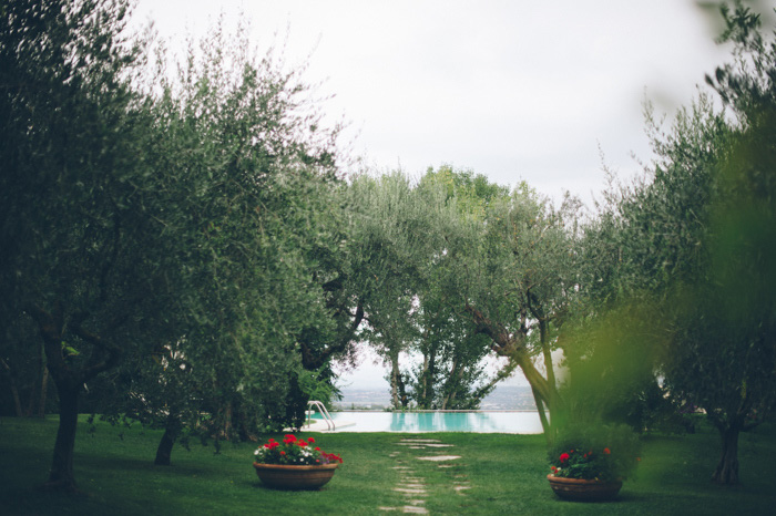 Picture Of intimate tuscan villa destination wedding under olive trees  2