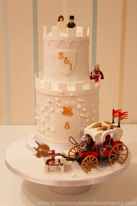 a white tower wedding cake with Lego figurines and a carriage and more figurines is ultimate fun for your dessert table