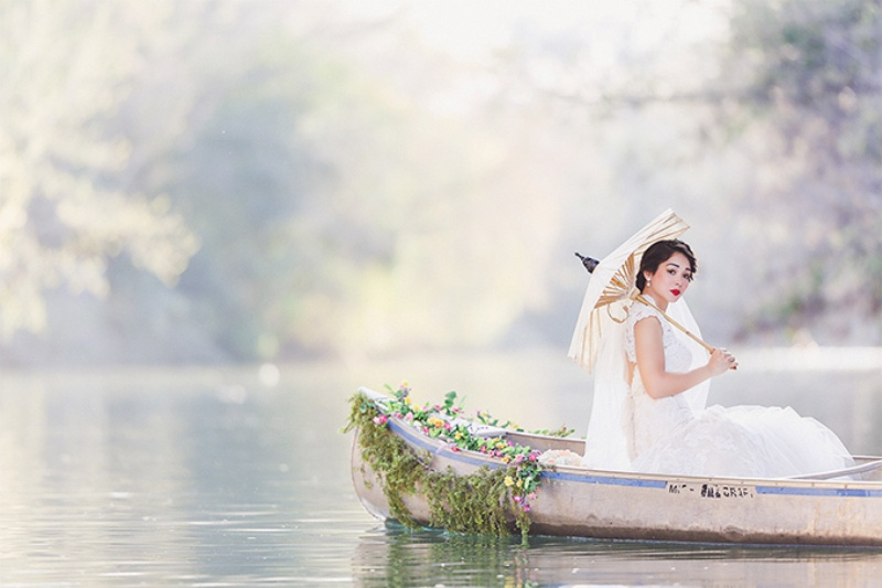 Picture Of lovely canoe trash the dress post wedding shoot in texas  7