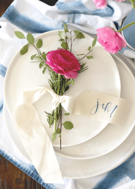 Picture Of lovely diy rosemary and ranunculus place card table settings  1