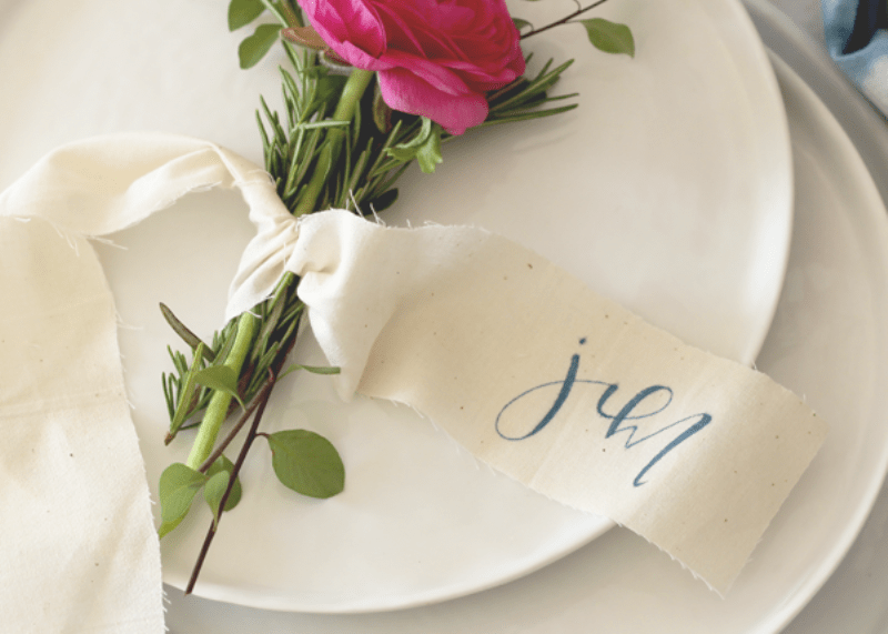 Picture Of lovely diy rosemary and ranunculus place card table settings  2