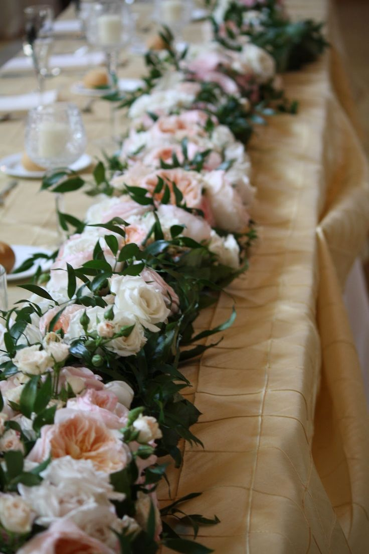 a lush greenery and pastel flower garland looks very tender and very romantic