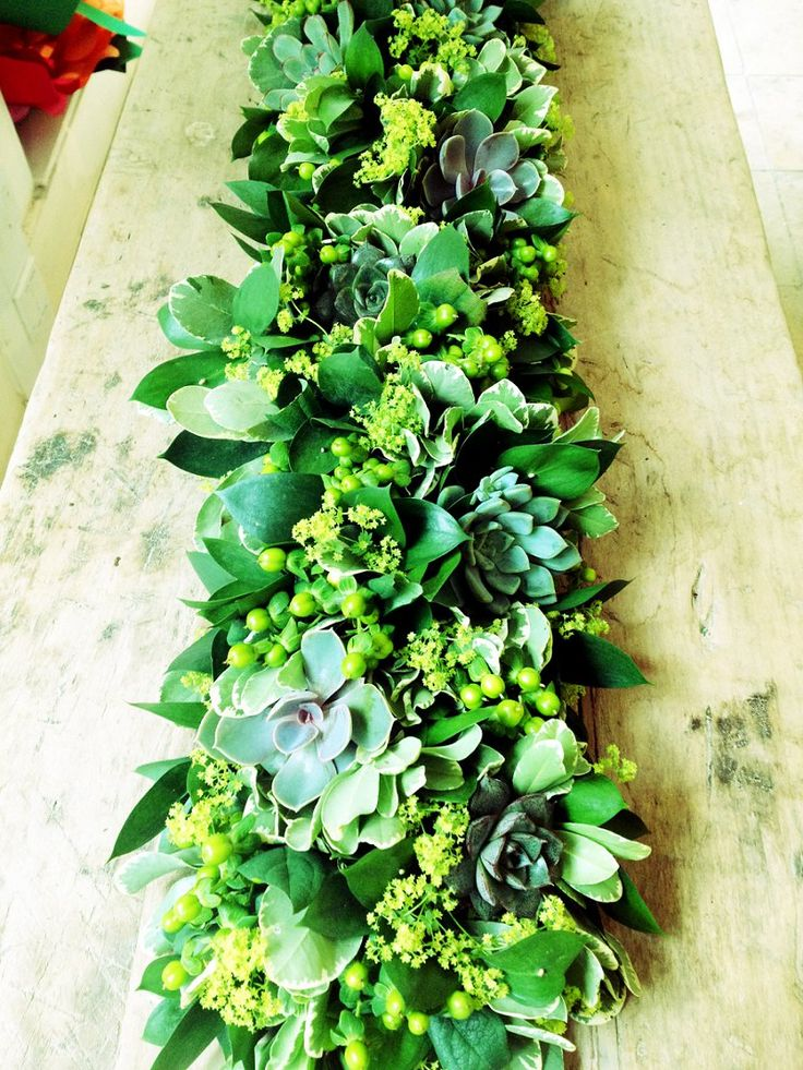 a textural greenery garland with some berries and pale succulents is a cool idea for a cozy natural feel