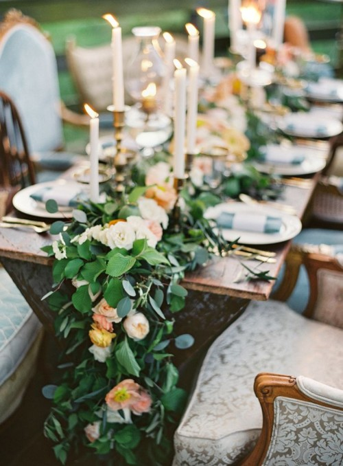 a lush greenery and pastel bloom garland is a very chic, tender and romantic idea