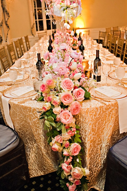 a greenery and pink bloom wedding table garland is a gorgeous idea for a refined and chic tablescape