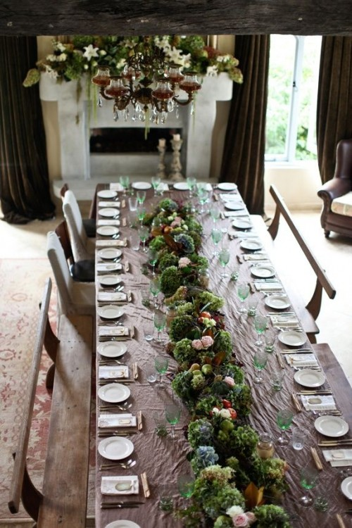 a greenery, moss and blooms wedding table garland is a cool and bold idea for any wedding