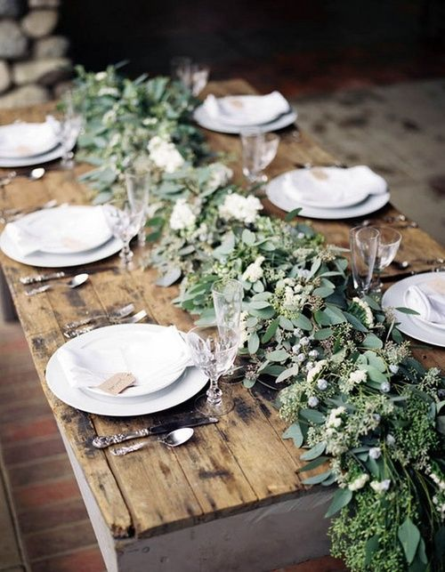 a textural greenery garland with berries is a chic natural idea to go for, perfect for a modern wedding