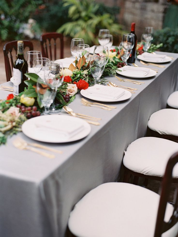 a greenery, bright blooms and grapes wedding table garland is a bright and cool idea for a Tuscany wedding