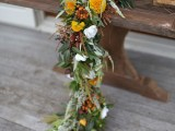 a textural fall-inspired table garland with white, marigold and brown blooms looks refined and unusual