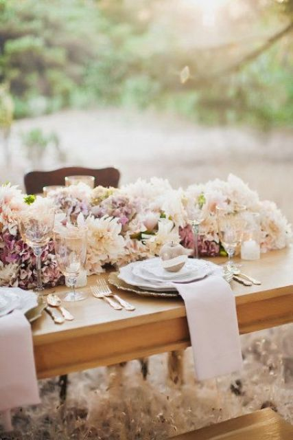a lush blush and mauve floral wedding table garland is a cute and very romantic idea for a spring or summer wedding