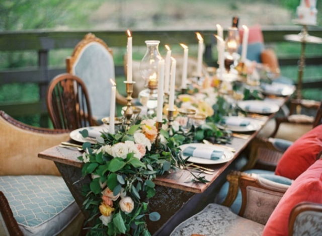 a lush greenery and neutral bloom garland and matching candles for a super chic and romantic feel