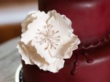 a marsala wedding cake with a white sugar bloom is lovely and bold idea for fall or winter