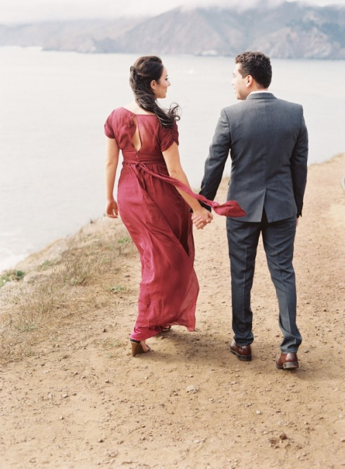 a marsala wedding dress with short draped sleeves, a cutout back and a sash is a lovely and bright idea for a fall bride
