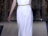 a minimalist flowy wedding dress with a halter neckline and an embellished sash to highlight the waist