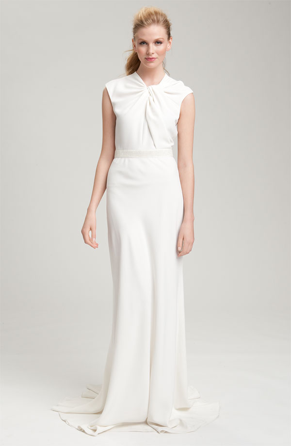 a minimalist wedding dress with a tied and draped bodice with cap sleeves and a maxi skirt with a train