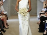 a minimalist one shoulder wedding dress with draperies and a long petal on the shoulder is a bold idea