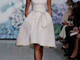 a strapless wedding ballgown with a fully knee skirt and a sash to highlight the waist is a cool option