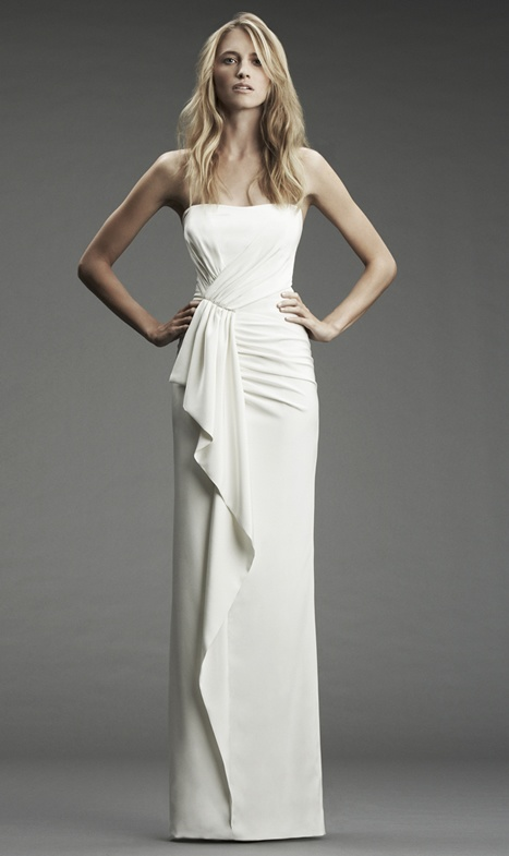 a strapless fitting wedding dress with draperies and ruffles for a modern and simple bridal look