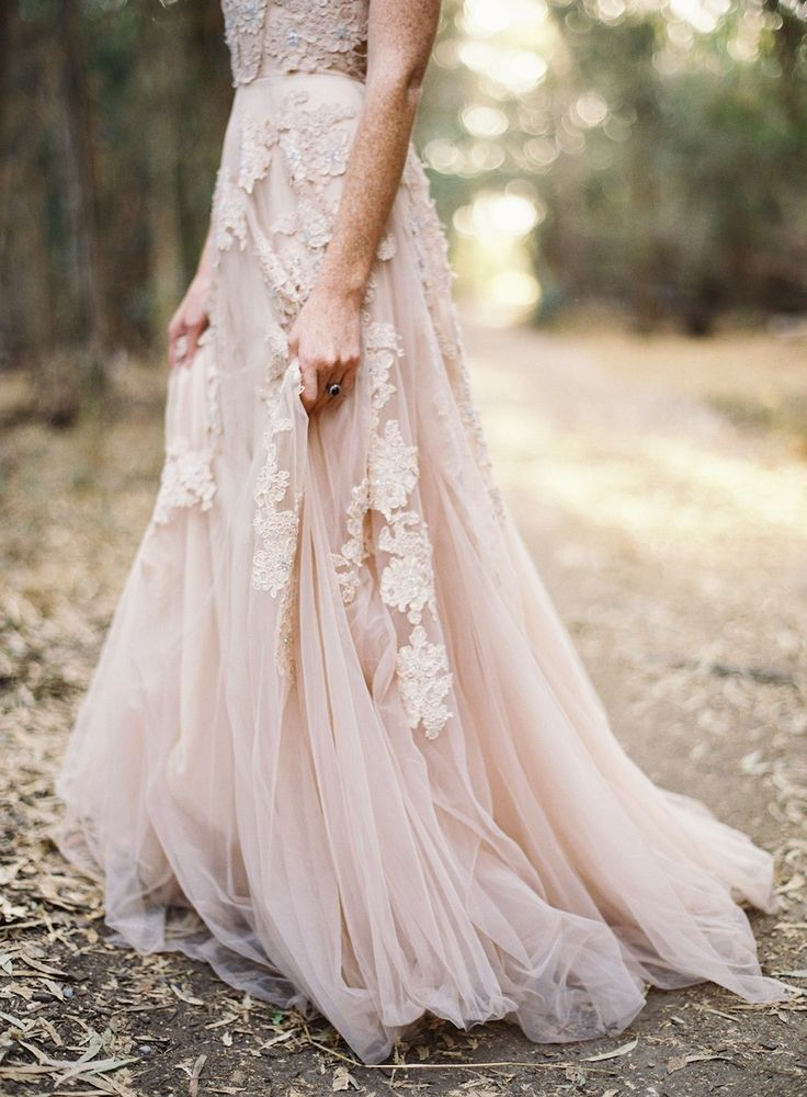 a blush lace A line wedding dress with floral appliques looks beautiful and very dreamy