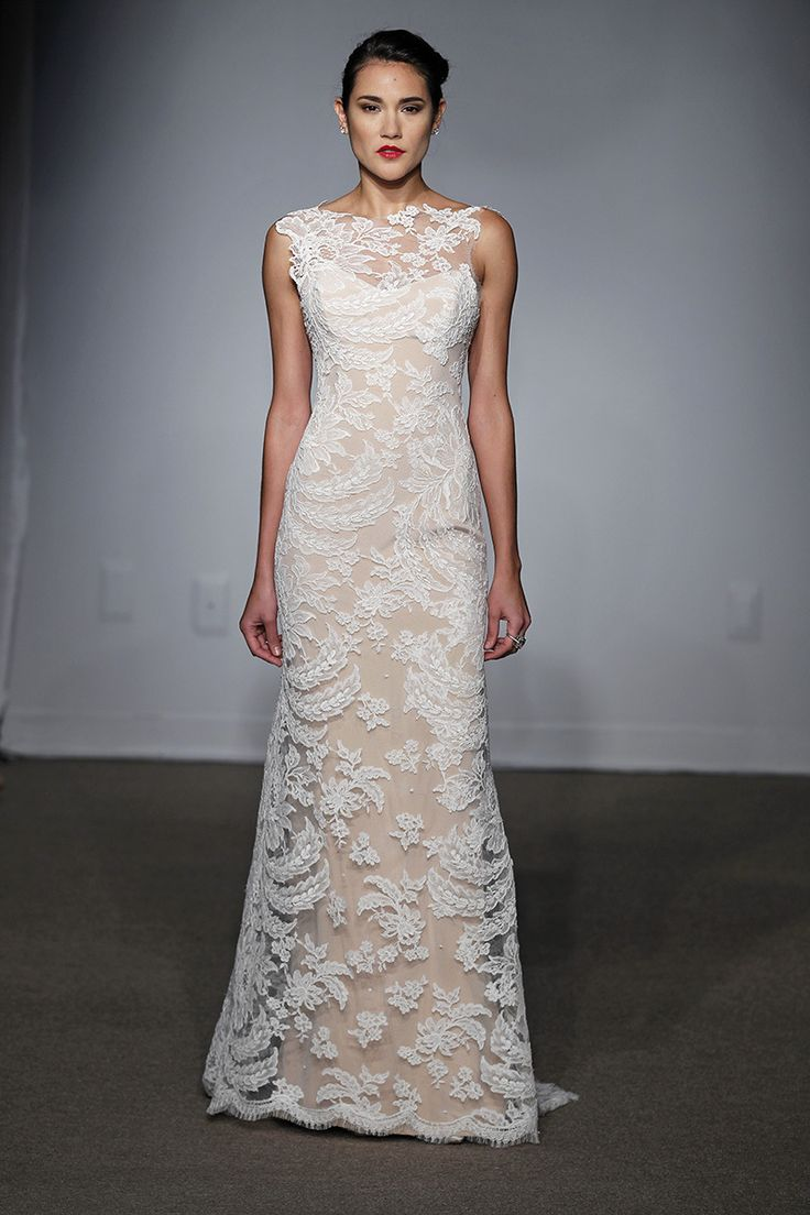 a nude lace A line wedding dress with an illusion neckline, no sleeves and a small train for a romantic look