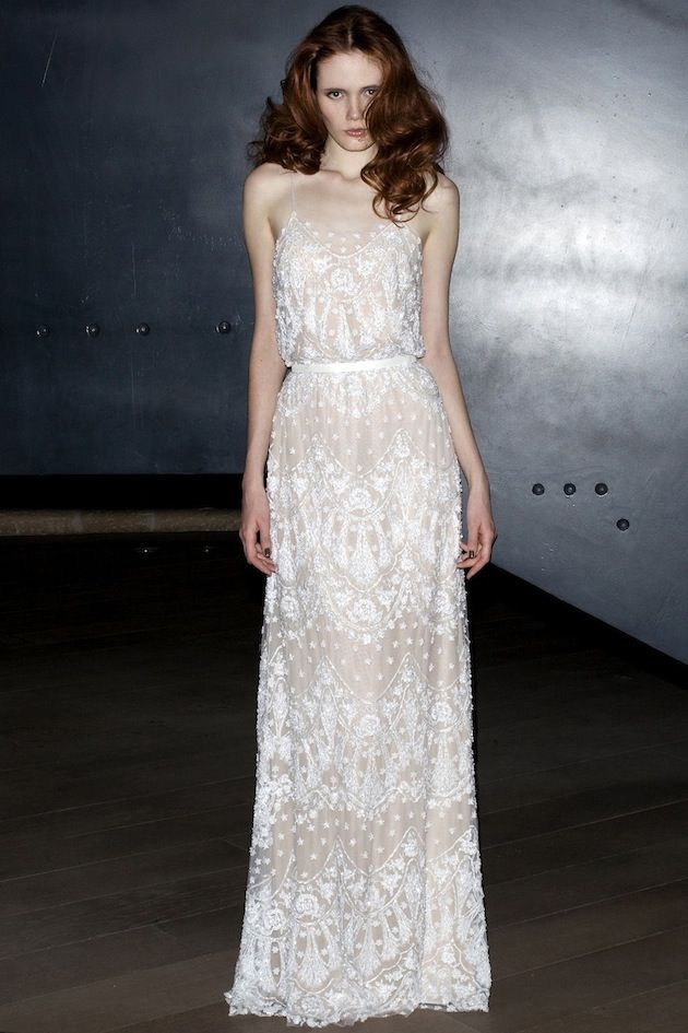 a folksy and boho nude lace A line wedding dress on spaghetti straps and with a sash is a creative idea