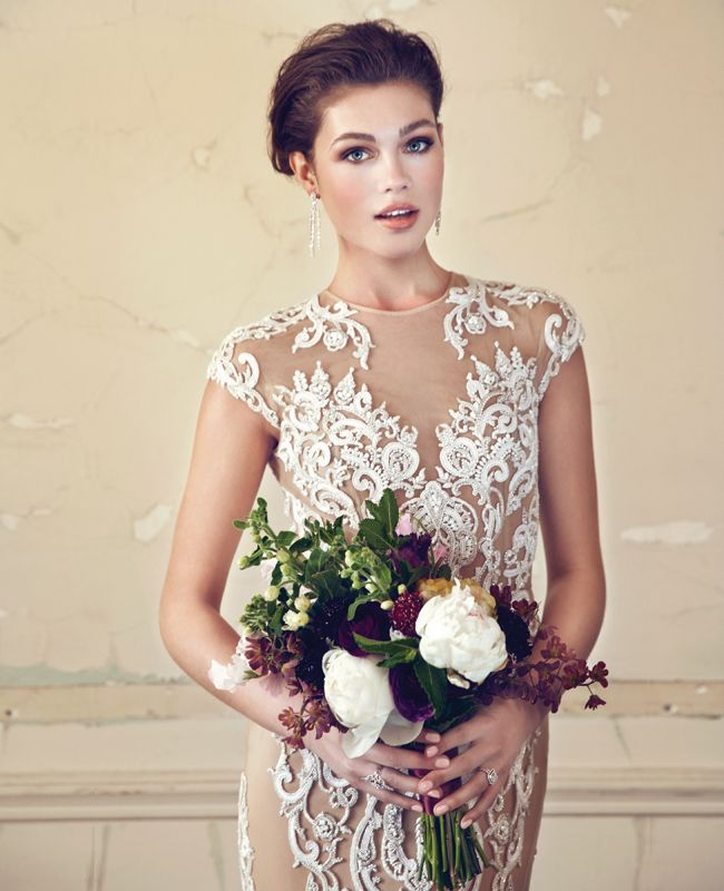 a glam nude lace fitting wedding dress with a high neckline and cap sleeves looks very chic and statement like