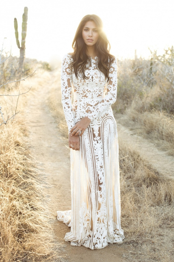 a boho nude lace fitting wedding dress with a high neckline and long sleeves plus a train is a bold idea