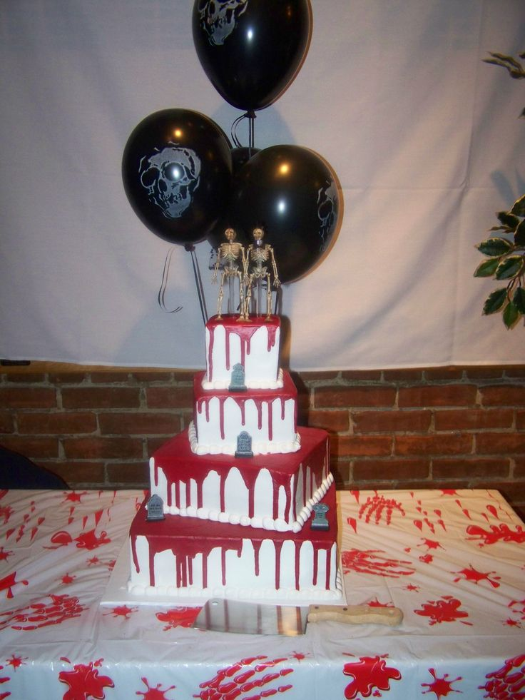 a bloody square wedding cake with grave stones and skeletons on top is a stylish idea for a Halloween wedding